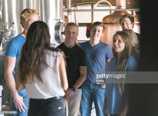 supervisor discussing with colleagues in brewery - visit stock pictures, royalty-free photos & images