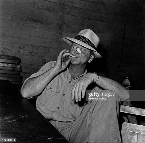 Supervisor enjoying a cigarette break United States circa 1950 Abbott took two series of logging photographs the first in the High Sierra Mountains...