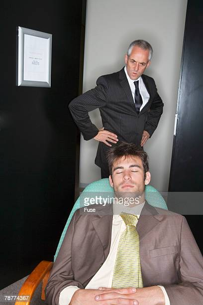 Supervisor Finding Office Worker Asleep