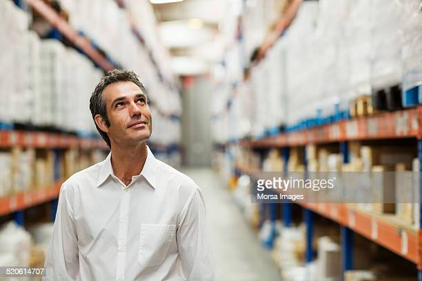 supervisor in warehouse - looking up stock pictures, royalty-free photos & images