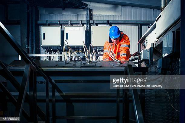 Supervisor monitoring equipment at industrial plant