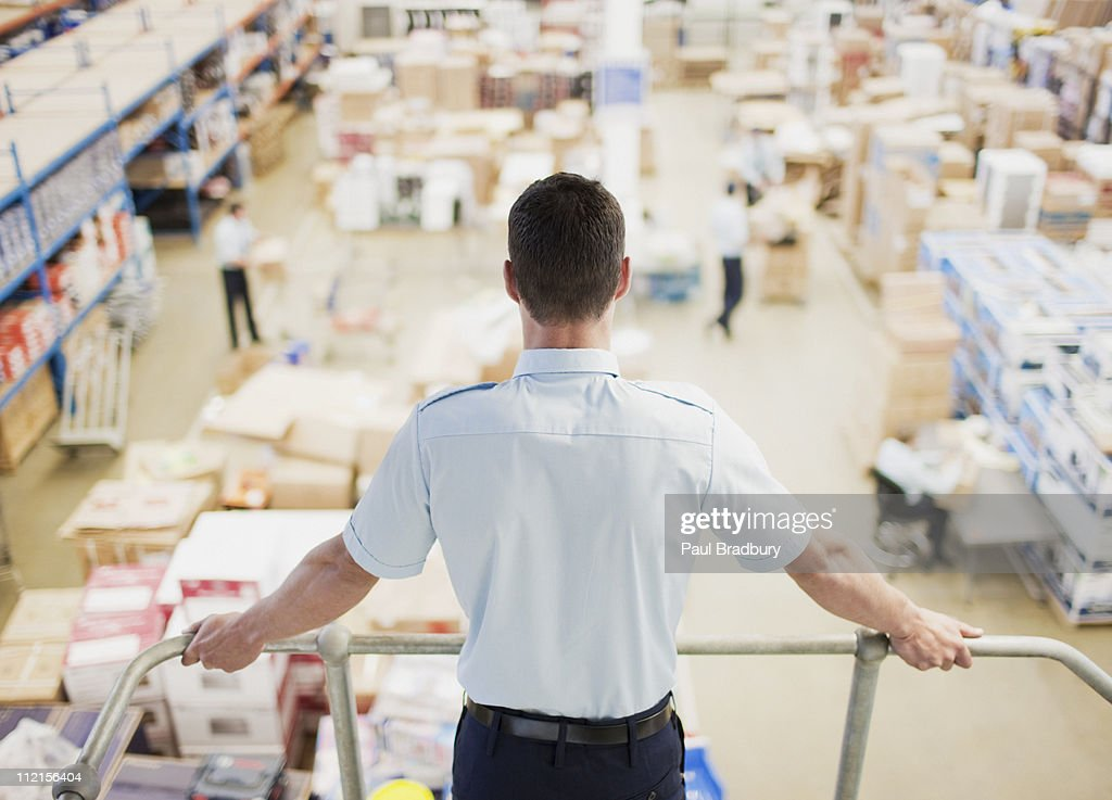 Supervisor  monitoring shipping work : Stock Photo