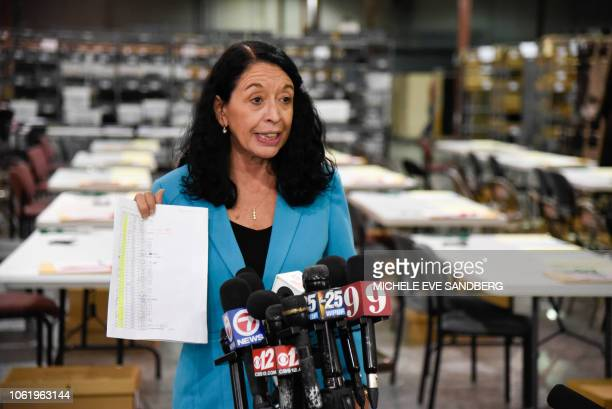 Supervisor of elections for Palm Beach County Susan Bucher holds up the vote tallies as she speaks with the media regarding not meeting the original...