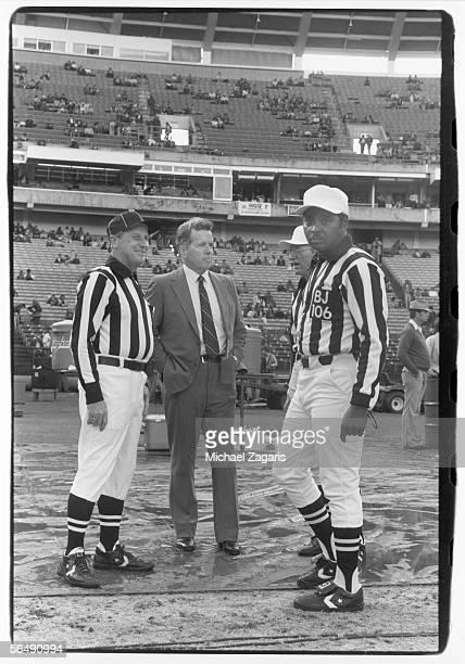 Supervisor of Officials Art McNally talks to officials after the game between the San Francisco 49ers and the Atlanta Falcons at the Atlanta Fulton...