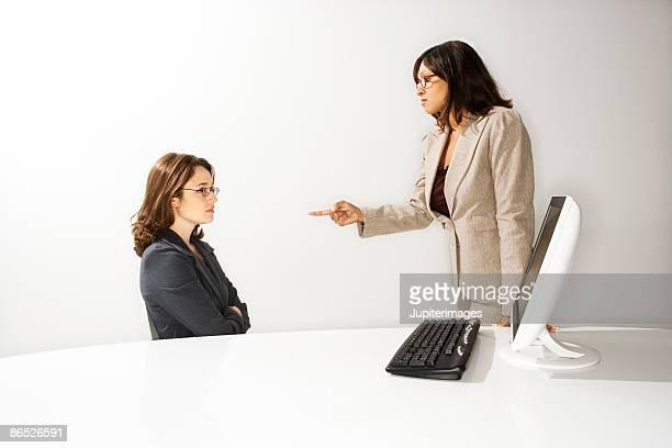 Supervisor scolding a subordinate