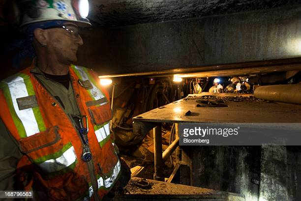 A supervisor stands outside a tunnel during longwall coal mining operations at the Consol Energy Bailey Mine in Wind Ridge Pennsylvania US on Tuesday...