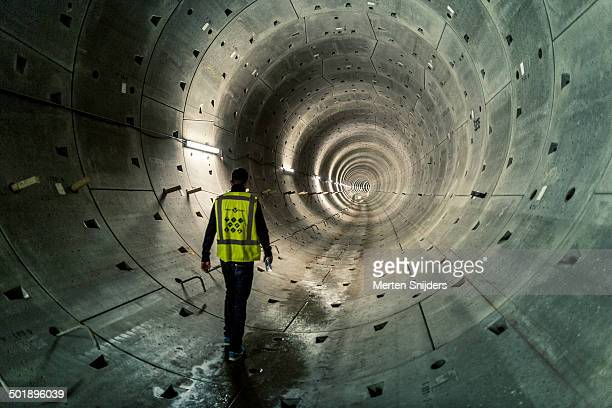 supervisor walking through subway tube - tunnel stock pictures, royalty-free photos & images