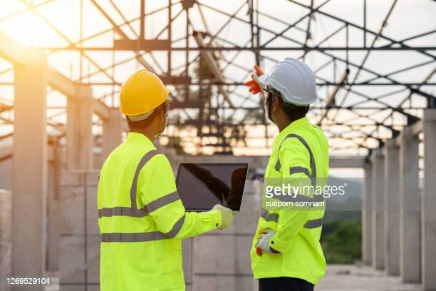 supervisors and engineering use laptop at the construction site - 578105427 stock pictures, royalty-free photos & images