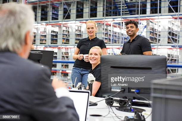Supervisors discussing at logistics center