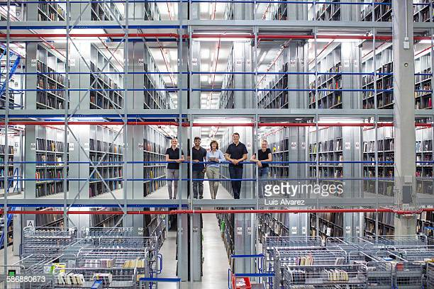Supervisors standing in logistics warehouse