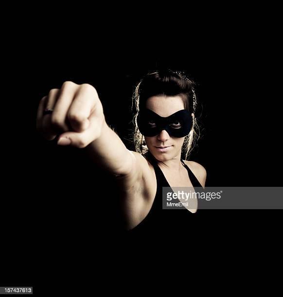 スーパーウーマン、ブラック - 男女の争い ストックフォトと画像