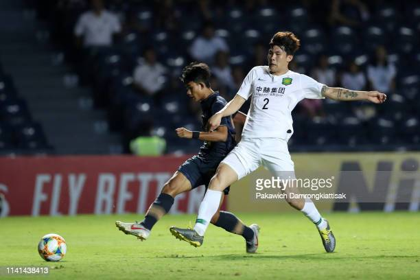 Suphanat Mueanta of Buriram United scores his side's first goal during the AFC Champions League Group G match between Buriram United and Beijing...
