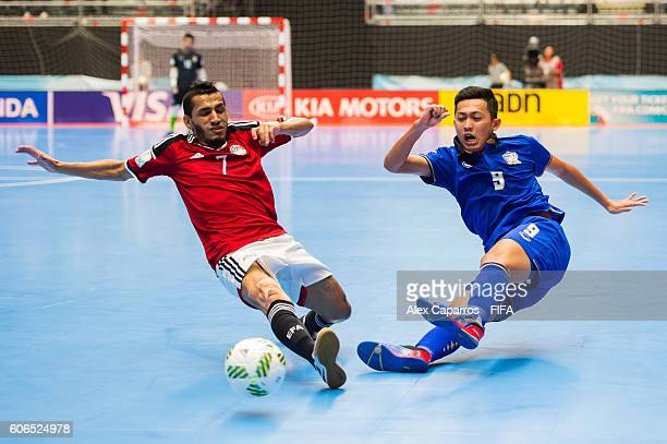 Suphawut Thueanklang of Thailand shoots the ball past Ibrahim Eika of Egypt during the FIFA Futsal World Cup Group B match between Egypt and Thailand...