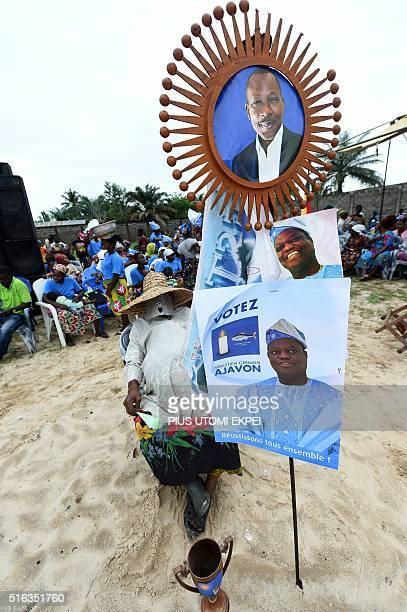 Suporters display banners picturing Sebastien Ajavon and presidential candidate and leader of coalition of the opposition Patrice Talon during a...