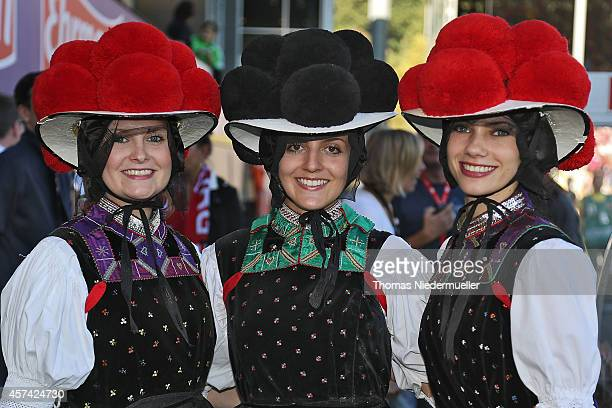 Suportersof Freiburg wearing a traditional 'Bollenhut' are seen prior to the Bundesliga match between SC Freiburg and VfL Wolfsburg at MAGE SOLAR...