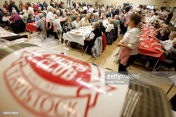 Images from Tavistock's annual sauerkraut and roast pork supper that usually attracts about 1500 people On stage the barrell full of raffle tickets...