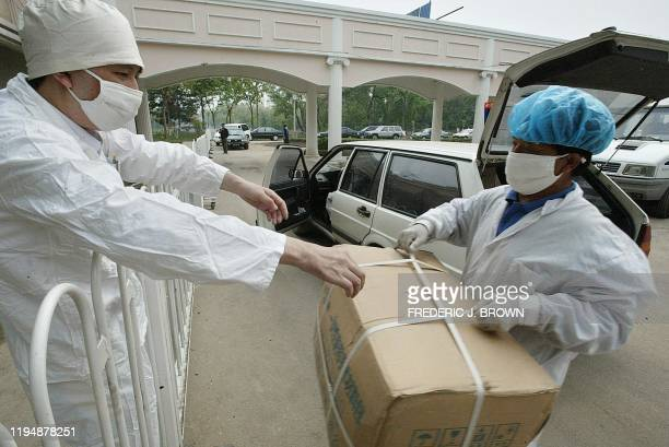 Supplies are delivered at the makeshift Severe Acute Respiratory Syndrome facility of Xiaotangshan hospital 07 May 2003 on the outskirts of Beijing...