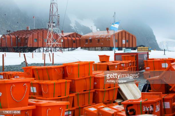 supplies at base orcadas which is an argentine scientific station in antarctica - south orkney island stock pictures, royalty-free photos & images