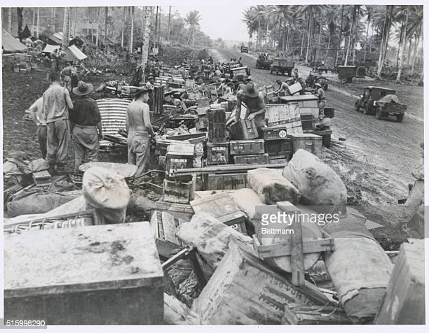 Supplies for troops at Balikpapan: Our photograph shows stores for the men in the landing of the seventh Australian division at Balikpapan on the...
