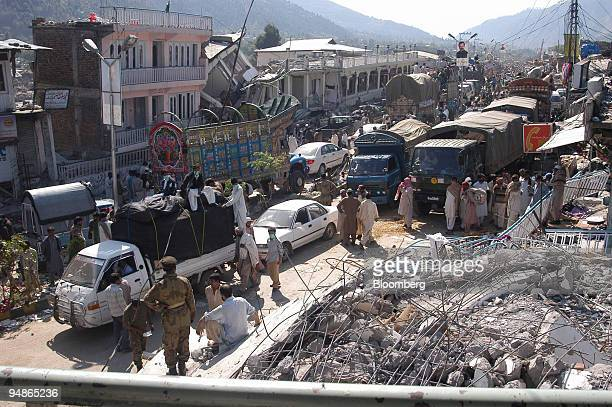 Supplies from various places arrive in Balakot northern Pakistan on Wednesday October 12 2005 Pakistan's government will immediately send two army...