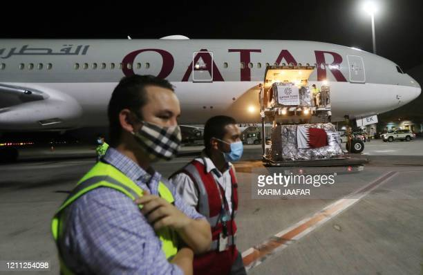 Supplies to tackle the coronavirus COVID-19 pandemic donated by the Qatar Fund for Development are loaded onto a Qatar Airways flight to Kigali in...