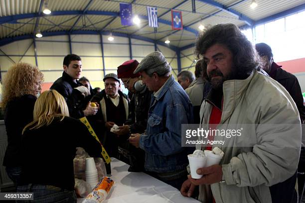 A supply and solidarity foundatiýon in Greece supplies food allowance to hundreds of people in need in a sport hall in Athens due to the Christmas on...