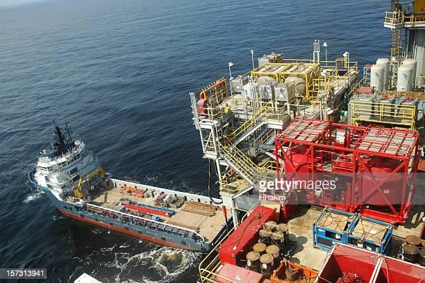 Supply boat at drilling rig