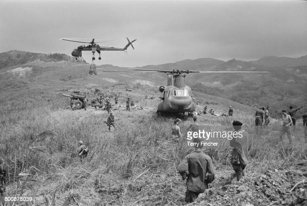 Supply helicopters and artillery on Hill Timothy during preparations for action against the Viet Cong, during the Vietnam War, April 1968.