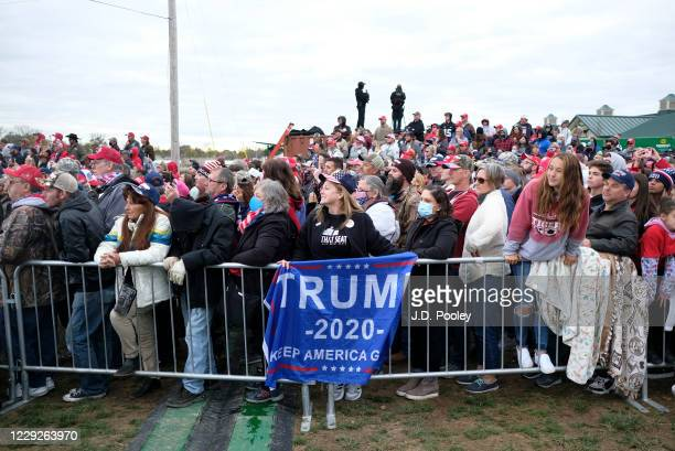 Suppoerters listen to U.S. President Donald Trump during a campaign event on October 24, 2020 in Circleville, Ohio. President Trump continues to...