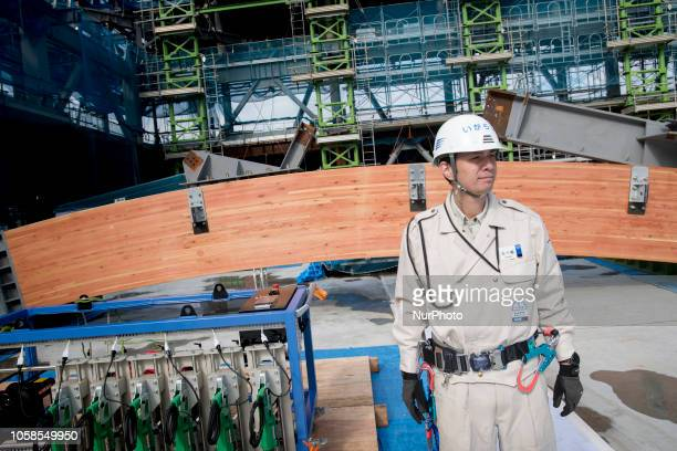 A support edge of the centre section of the timber roof is displayed during a press preview for the raising of part of the roof at the Ariake...