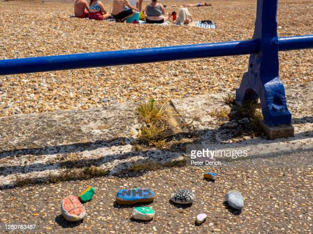 Support for the NHS painted on pebbles at Eastbourne beachon June 2,2020 in Eastbourne,England.