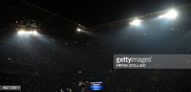 Support for typhoon victims on the Philippines is displayed on a screen prior to the UEFA Champions League Group F football match Borussia Dortmund...