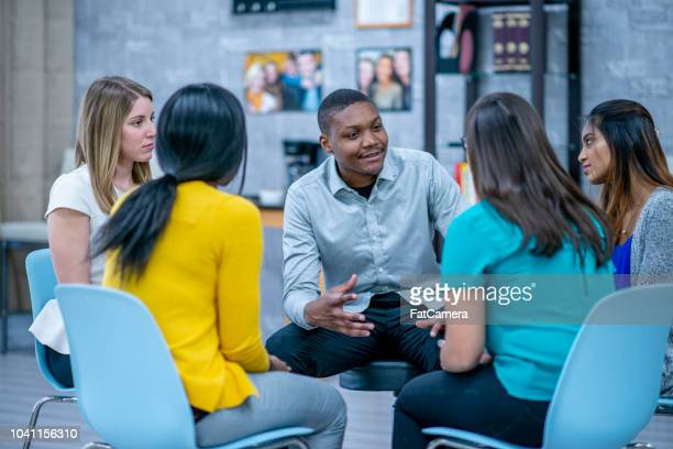 support group session - small group of people stock pictures, royalty-free photos & images