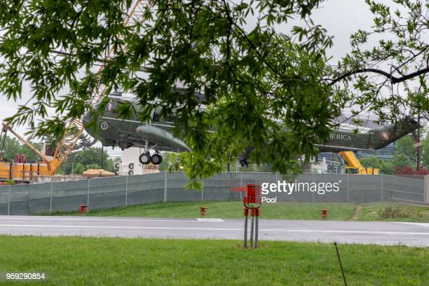 A support helicopter carrying staff lands prior to the landing of Marine On carrying US President Donald Trump as he visits first lady Melania Trump...