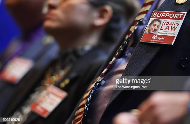 A Support Noah's Law button is worn during a MADD press conference to release a nationwide report showing that ignition interlock devices save lives...