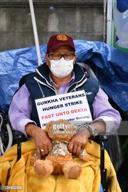 Support Our Gurkhas protester Dhan Gurung holds a teddy bear as he continues a hunger strike during a demonstration for equal pensions, outside...