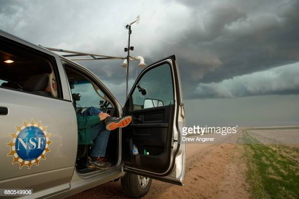 Support scientist Tim Marshall a 40 year veteran of storm chasing relaxes in the tornado scout vehicle during the last storm of their day May 8 2017...