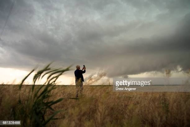 Support scientist Tim Marshall a 40 year veteran of storm chasing photographs supercell thunderstorm during a tornado research mission May 9 2017 in...