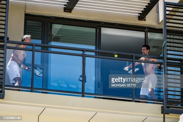 Support Staff and Serbian World No.1 Tennis player Novak Djokovic playing tennis on a balcony where they are quarantined at the M Suites in North...