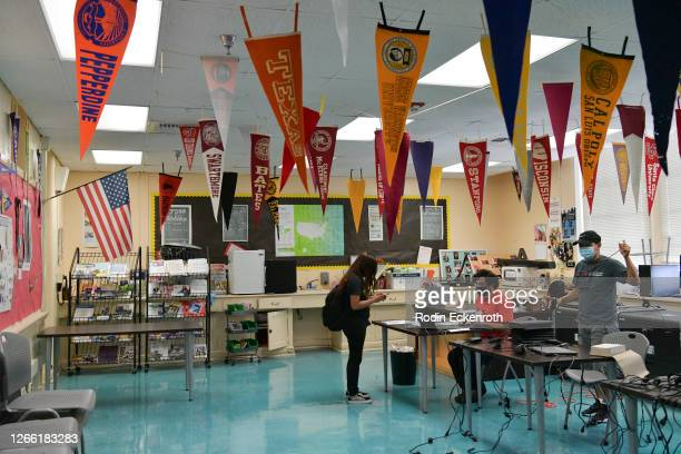 Support Technician Michael Hakopian distributes computer devices to students at Hollywood High School on August 13, 2020 in Hollywood, California....
