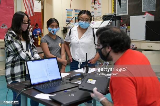 Support Technician Michael Hakopian distributes devices to students at Hollywood High School on August 13, 2020 in Hollywood, California. With over...