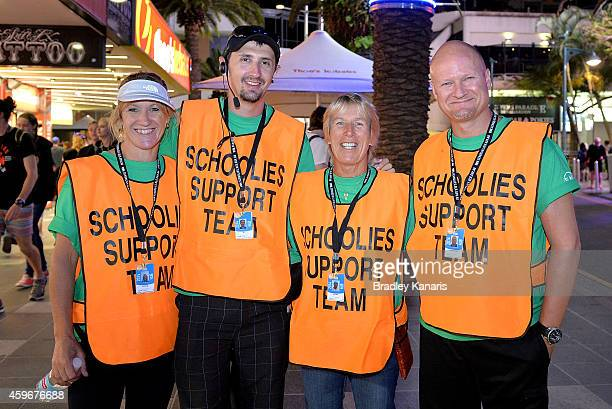 Support volunteers pose for a photo during Australian 'schoolies' celebrations following the end of the year 12 exams on November 28 2014 in Gold...