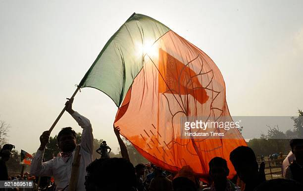 BJP support with party flag during election campaign rally of Prime Minister Narendra Damodardas Modi before third phase of Assembly Election at...