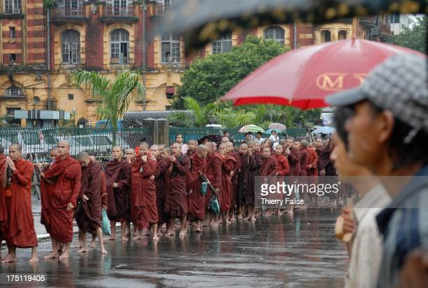 Supported by a crowd of civilians Burmese Buddhist monks protesting against the military junta are gathering near the Sule pagoda one of the most...