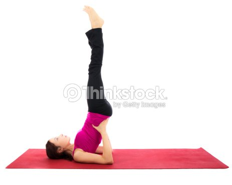 supported shoulder stand pose in yoga stock photo  thinkstock