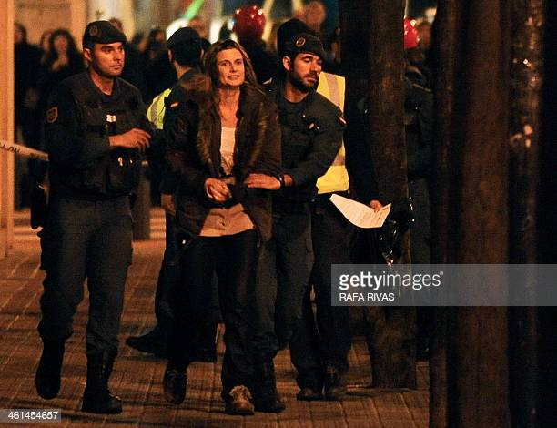 ETA supporter Aitziber Sagarminaga is taken to a police car after attending a search at a ETA lawyers' office following her arrest in the northern...