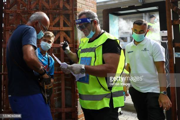 Supporter are seen at the entrance ,where their tickets were checked prior to the pre-season friendly match between SSC Napoli and Castel Di Sangro...