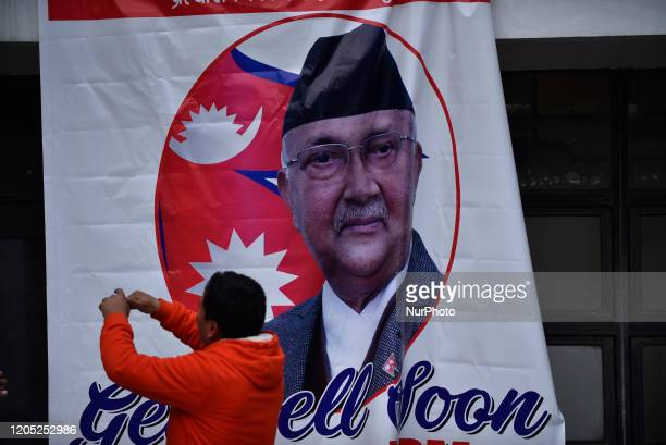 A Supporter arranging poster with GET WELL SOON around hospital premises during second time Kidney transplant of Prime Minister KP Sharma Oli at...