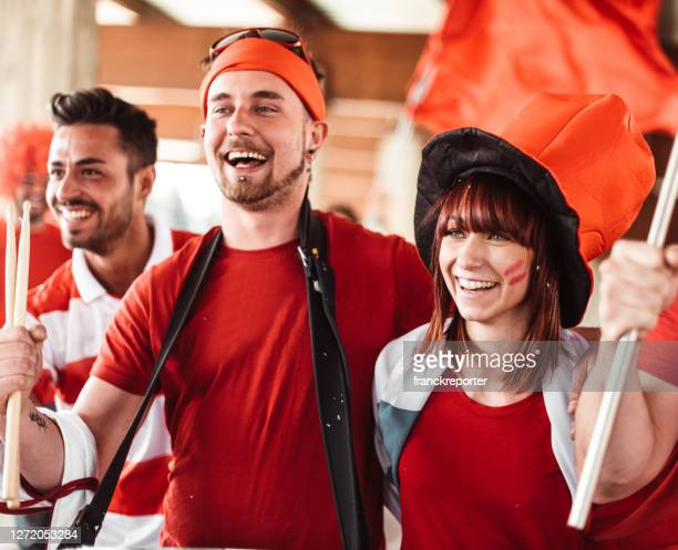 supporter at the stadium for the match - fan enthusiast stock pictures, royalty-free photos & images