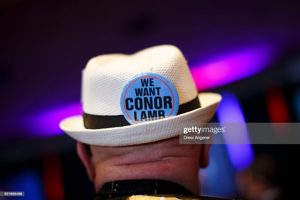 A supporter attends an election night event for Conor Lamb, Democratic congressional candidate for Pennsylvania's 18th district, March 13, 2018 in Canonsburg, Pennsylvania. As of 10:00 PM, Lamb's race against Republican candidate Rick Saccone is still too close to call.